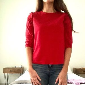 Red tee with details on 3/4 sleeves